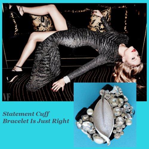 Taylor Swift reclining sofa tiger dress Vanity Fair