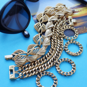 gold bracelets and post card